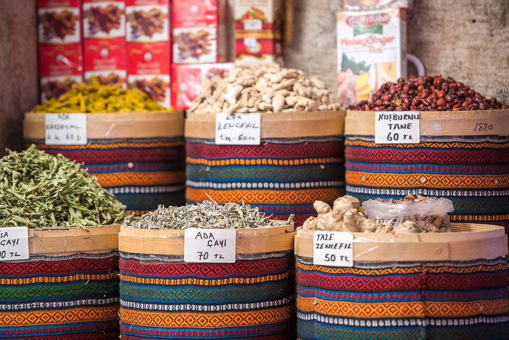 Multicolored baskets hold an array of spices and dried goods out on display for sale at Istanbul Spice bazaar in Turkey