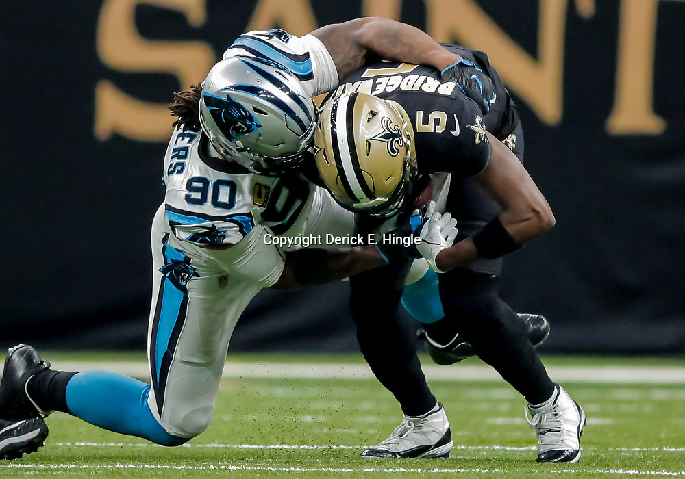 Dec 30, 2018; New Orleans, LA, USA; Carolina Panthers defensive end Julius Peppers (90) sacks New Orleans Saints quarterback Teddy Bridgewater (5) during the second quarter at the Mercedes-Benz Superdome. Mandatory Credit: Derick E. Hingle-USA TODAY Sports