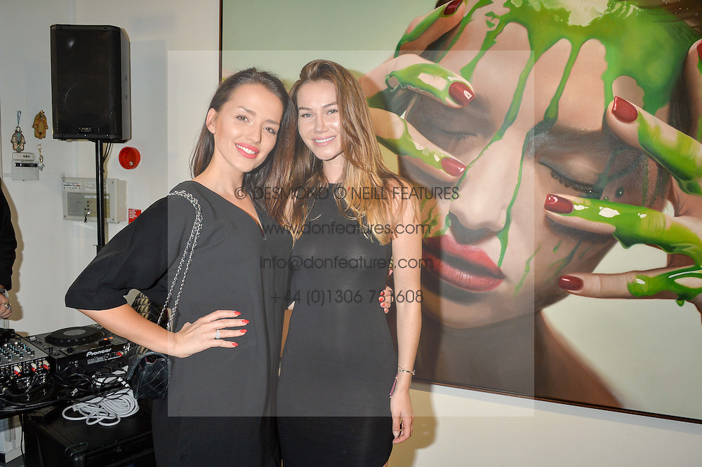 Left to right, VALERIA COSTA MARTINEZ and KAROLINA POGO at a private view of woks by German artist Mike Dargas held at the Opera Gallery, 134 New Bond Street, London on 5th July 2016.