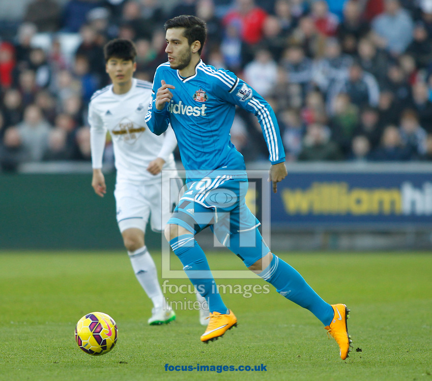 Ki Sung-Yeung of Swansea City and Ricky Alvarez of Sunderland during the Barclays Premier League match at the Liberty Stadium, Swansea<br /> Picture by Mike Griffiths/Focus Images Ltd +44 7766 223933<br /> 07/02/2015
