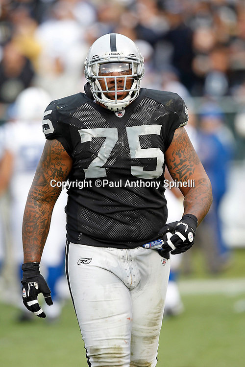 Oakland Raiders offensive tackle Mario Henderson (75) walks off the field during the NFL week 16 football game against the Indianapolis Colts on Sunday, December 26, 2010 in Oakland, California. The Colts won the game 31-26. (©Paul Anthony Spinelli)