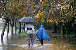 Father and son walking on PST path full of water after heavy rain on September 18, 2010, in Ljubljana, Slovenia. (Photo by Matic Klansek Velej / Sportida)