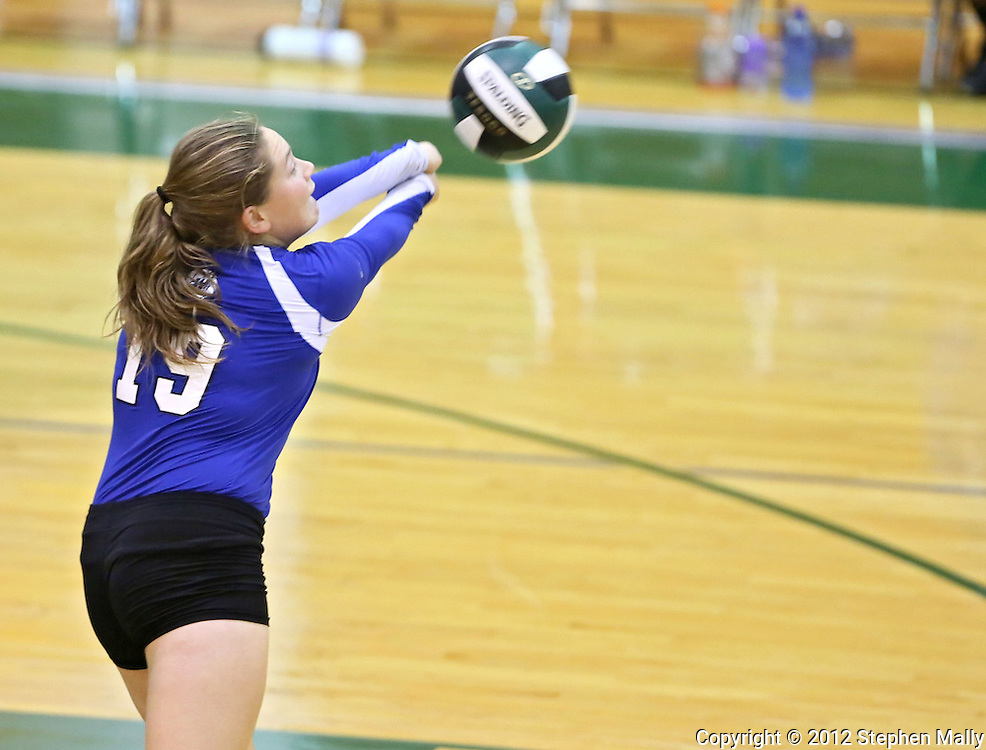 Washington's Kirsten Peterson (19) just reaches a ball during the MVC Volleyball Tournament Championship game between the Hempstead Mustangs and the Washington Warriors at Kennedy High School in Cedar Rapids on Saturday October 13, 2012. Hempstead defeated Washington 25-21 25-19.