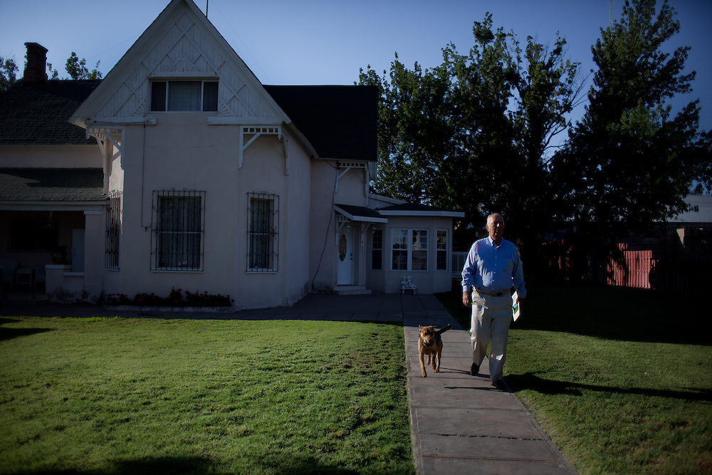 Kent Romney walks with his dog outside his home in Colonia Juarez, Mexico in July 2011. United States Presidential candidate Mitt Romney's family migrated to Mexico over 100 years ago after being granted asylum from Mexican President Porfirio Diaz after they had been pursued by the U.S. authorities for polygamy. ..(Romney is currently running for the Republican nomination.)