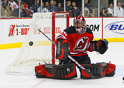 Dec 10, 2008; Newark, NJ, USA; New Jersey Devils goalie Scott Clemmensen (35) makes a save during the third period at the Prudential Center. The Devils defeated the Penguins 4-1.