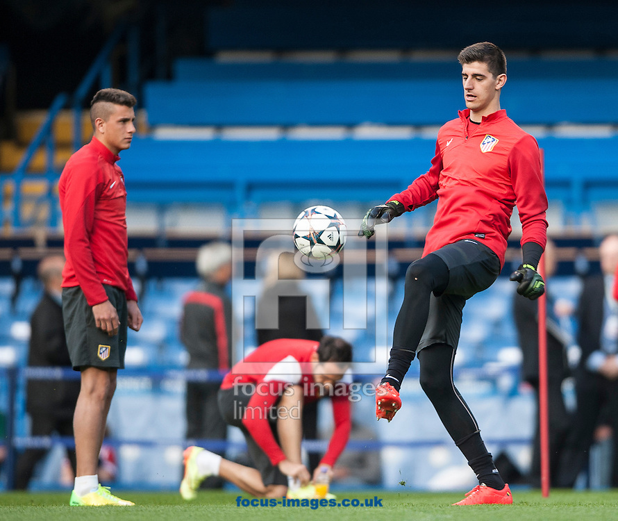 Atletico Madrid's goal keeper Thibaut Courtois (right) during training at Stamford Bridge, London ahead of their UEFA Champions League semi final second leg against Chelsea.<br /> Picture by Daniel Hambury/Focus Images Ltd +44 7813 022858<br /> 29/04/2014
