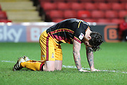 Bradford City midfielder Romain Vincelot (6)  on his hands and knees during the EFL Sky Bet League 1 match between Charlton Athletic and Bradford City at The Valley, London, England on 14 March 2017. Photo by Matthew Redman.