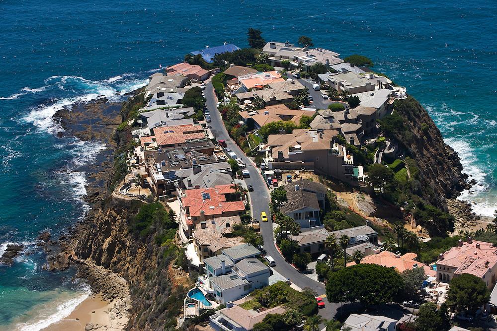An aerial of beach homes sitting on the cliffs of one of many coves in Laguna Beach,Pacific Ocean,Laguna Beach, California,USA