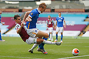 Brighton and Hove Albion defender Dan Burn (33) shields the ball from Ashley Westwood of Burnley (18)  during the Premier League match between Burnley and Brighton and Hove Albion at Turf Moor, Burnley, England on 26 July 2020.