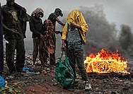 In southern Mozambique, in the heart of Maputo and just a few meters from the airport of the capital, is the dump of Hul&eacute;ne. Mother of many stories, home of many renegades and maintenance of many more. It?s hard to achieve any kind of judgment, when incredulity upheaves any soul or intellectual perception.The limits of the trash, a cut south for a makeshift entrance, a massive hole in the wall of cement, concrete and rough, exceed even the common sensitivity - and even the perspicuity of the look - and not even the walls that imprison her, can hide such nasty scenario. <br /> There converge all sorts of needs and purposes. Constant movement of trucks and people make up a complex interplay of colors and sensations that awaken us to the doorstep of the poor and insensitive. There are many characters, but very few differences.<br /> The &quot;garbage collectors&quot; are the ones who shake their horizons. They are the pawns of a few businesses, and perhaps more profitable, they can still flourish among the deepest and most desperate filthiness - recycling. Desperate, they try to frantically stick the roads of garbage in search of some utility. Because that utility there, and to them, can later be worth a little more bread and milk.