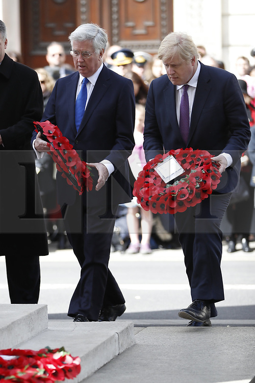 © Licensed to London News Pictures. 25/04/2017. London, UK. Defence Sectetary Michael Fallon and Foreign Secretary Boris Johnson attend the ANZAC wreath laying ceremony at the Cenotaph in Whitehall. A dawn ceremony and service was held at The Australian War Memorial and The New Zealand War Memorial at Hyde Park Corner.  April 25th is the day that Australia and New Zealand remember the dead of all wars. Photo credit: Peter Macdiarmid/LNP