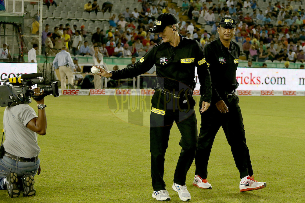 Standing umpires S Ravi and Billy Bowden walking out onto the field during match 5 of the Oppo Champions League Twenty20 between the Kings XI Punjab and the Barbados Tridents held at the Punjab Cricket Association Stadium, Mohali, India on the 20th September 2014. Photo by:  Jacques Rossouw / Sportzpics/ CLT20<br /> <br /> <br /> Image use is subject to the terms and conditions as laid out by the BCCI/ CLT20.  The terms and conditions can be downloaded here:<br /> <br /> http://sportzpics.photoshelter.com/gallery/CLT20-Image-Terms-and-Conditions-2014/G0000IfNJn535VPU/C0000QhhKadWcjYs