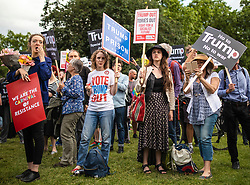 © Licensed to London News Pictures. 03/06/2019. London, UK. Protesters demonstrate against President of the United States Donald Trump outside Buckingham Palace, where President Trump will attend a State Banquet this evening. President Trump is in the UK for a three-day State Visit. Photo credit: Rob Pinney/LNP