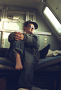 Woman traveller sitting in her van. looking up at sunlight coming in through a window, Dresden Germany, 2000's,