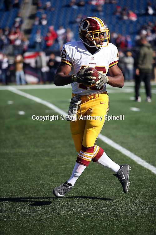 Washington Redskins running back Alfred Morris (46) catches a pregame pass while warming up before the 2015 week 9 regular season NFL football game against the New England Patriots on Sunday, Nov. 8, 2015 in Foxborough, Mass. The Patriots won the game 27-10. (©Paul Anthony Spinelli)