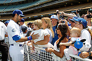 LOS ANGELES, CA - JUNE 30:  Andre Ethier #16 of the Los Angeles Dodgers greets fans at fan photo day before the game against the New York Mets on Saturday, June 30, 2012 at Dodger Stadium in Los Angeles, California. The Mets won the game in a 5-0 shutout. (Photo by Paul Spinelli/MLB Photos via Getty Images) *** Local Caption *** Andre Ethier