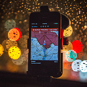 WASHINGTON, DC - APR 4:  The Uber driver app on the windshield of UberX driver Regan Rucker, indicates surge pricing during peak ridership on Friday night, April 4, 2014, in Washington, DC. Rucker, a single mom who recently started driving for UberX, likes the flexibility of UberX because she can work whenever and however long she wants, and earns good money driving for Uber.<br /> <br /> Thousands of local car owners have signed up in recent months to drive with one of the &quot;ride-share&quot; operators that use smartphone apps to link people needing rides with car owners willing to give them, for a price. (Photo by Evelyn Hockstein/For The Washington Post)