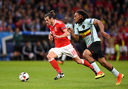 Gareth Bale of Wales takes the ball past Jason Denayer of Belgium  - Mandatory by-line: Joe Meredith/JMP - 01/07/2016 - FOOTBALL - Stade Pierre Mauroy - Lille, France - Wales v Belgium - UEFA European Championship quarter final
