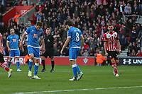 Football - 2016 / 2017 Premier League - Southampton vs.AFC Bournemouth<br /> <br /> Bournemouth's Harry Arter turns to look at the pitch after missing a penalty as team mate Dan Gosling replaces the divot of grass at St Mary's Stadium Southampton<br /> <br /> COLORSPORT/SHAUN BOGGUST