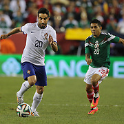 Rúben Amorim, (left), Portugal, breaks clear from Javier Aquino, Mexico, during the Portugal V Mexico International Friendly match in preparation for the 2014 FIFA World Cup in Brazil. Gillette Stadium, Boston (Foxborough), Massachusetts, USA. 6th June 2014. Photo Tim Clayton