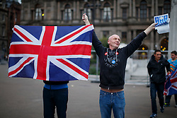 © Licensed to London News Pictures. 18/09/2014. Glasgow, UK. A group of Unionists posing to Scottish Independence campaigners who met at George Square in Glasgow whilst people of Scotland going to polling stations to vote on the Scottish independence referendum on Thursday, 18 September 2014. Photo credit : Tolga Akmen/LNP