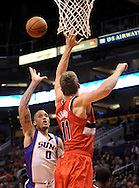 Nov. 21, 2012; Phoenix, AZ, USA; Phoenix Suns forward Michael Beasley (0) puts up the ball during the game against the Portland Trail Blazers center Meyers Leonard (11) in the second half at US Airways Center. The Suns defeated the Trail Blazers 114-87. Mandatory Credit: Jennifer Stewart-US PRESSWIRE