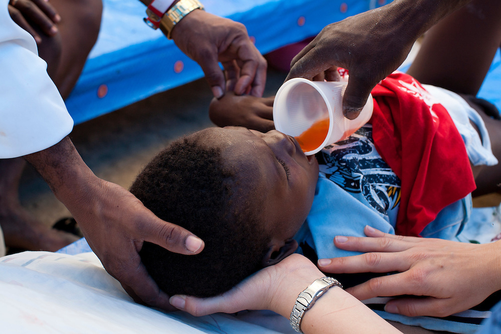 Dekay Bossam is treated for cholera at a clinic on Friday, November 26, 2010 in Cabaret, Haiti.