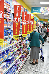 An elderly woman shops in Poundland with her zimmer frame UK