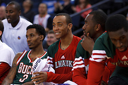 Mar 16, 2012; Oakland, CA, USA; Milwaukee Bucks point guard Monta Ellis (center) reacts at the end of the game against the Golden State Warriors at Oracle Arena. Milwaukee defeated Golden State 120-98. Mandatory Credit: Jason O. Watson-US PRESSWIRE
