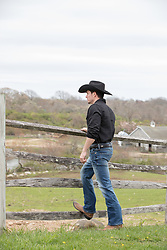 cowboy looking at a ranch