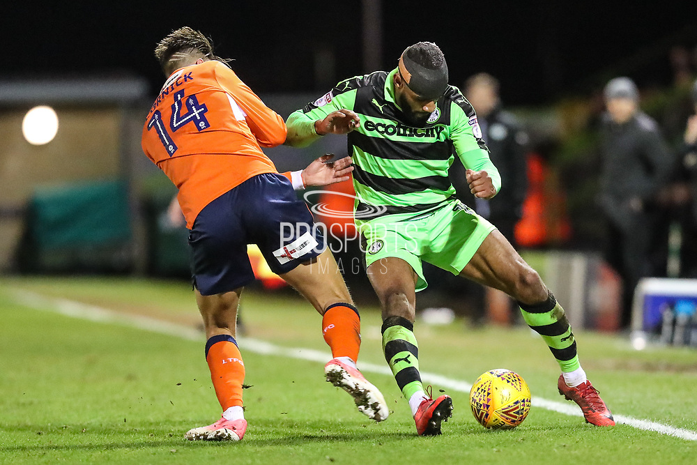 Forest Green Rovers Dan Wishart(17) shields the ball from Luton Town's Harry Cornick during the EFL Sky Bet League 2 match between Forest Green Rovers and Luton Town at the New Lawn, Forest Green, United Kingdom on 16 December 2017. Photo by Shane Healey.