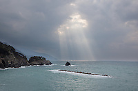 Light parts the clouds off the Italian coast near Monterosso al Mare