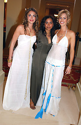 Left to right, LAURE DE CLERMONT-TONNERRE, fashion designer SYBIL STANISLAUS and CAROLINE HABIB  at a fashion show of Sybil Stanislaus Summer 2005 collection with jewellery by Philippa Holland held at The Lanesborough Hotel, Hyde Park Corner, London on 13th April 2005.<br />