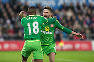 Jermain Defoe of Sunderland celebrates scoring his side's first goal with Fabio Borini of Sunderland during the Barclays Premier League match between Swansea City and Sunderland at the Liberty Stadium, Swansea, Wales on 13 January 2016. Photo by Mark Hawkins.