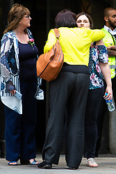 Roz Wickens, left, mother of Charlotte Brown leaves the Old Bailey as her daughter Katie is hugged by a family member after watching the trial of Jack Shepherd from Abergavenny, Wales, who is absent from his trial on charges of manslaughter following the death of Charlotte 'Charli' Brown, 24, who died following the capsizing of Shepherd's speedboat during a late night cruise on the River Thames in 2015. London, July 04 2018.