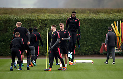 Arsenal's Calum Chambers, (centre) Rob Holding and Danny Welbeck (right) during the training session at London Colney, Hertfordshire.
