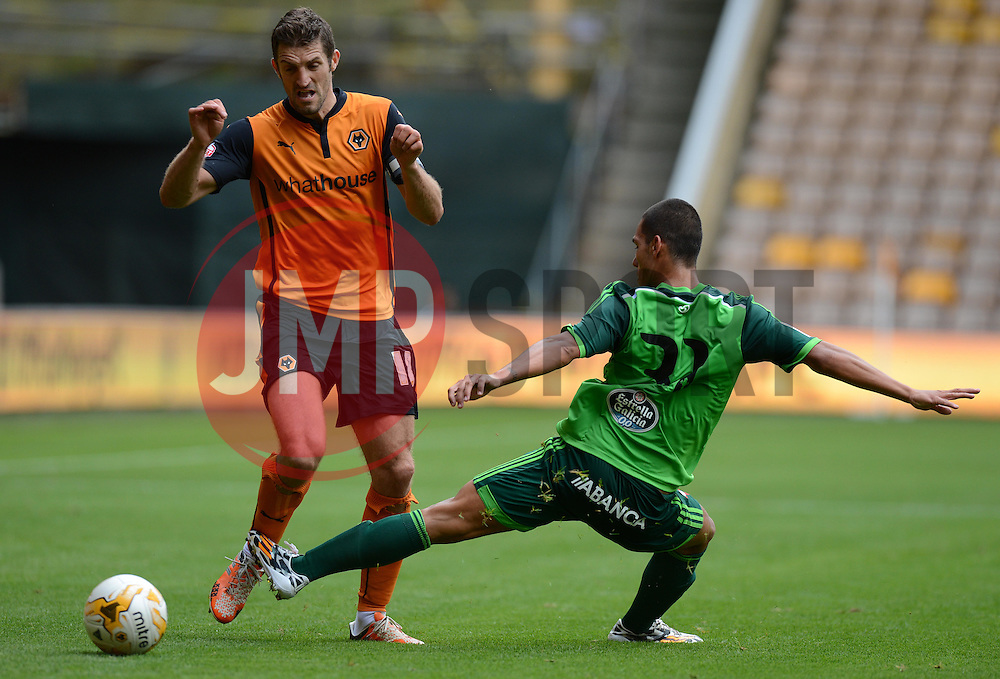 Celta Vigo's Samu fouls Wolverhampton's Samuel Ricketts  - Photo mandatory by-line: Alex James/JMP - Tel: Mobile: 07966 386802 2/08/2014 - SPORT - FOOTBALL - Wolverhampton  - Molineux Stadium -   Wolverhampton vs  Celta Vigo - preseason