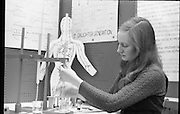 """Aer Lingus Young Scientist of the Year..1971..08.01.1971..01.08.1971..8th January 1971..The annual Aer Lingus Young Scientist of the year was held in The R.D.S.Dublin.Once again, this year,there was an outstanding display of projects by school children from around the country,many of which,it is hoped,will have applications into the future. The main speaker at the event was Mr Patrick Faulkner TD, Minister for Education..Pictured preparing her project is Ms Joyce Greene a pupil of the Holy Trinity College,Cork. Ms Greene was runner up in this years' event with her project on 'Air pollution and the effects on the human body""""."""