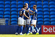 Goal - Callum Paterson (13) of Cardiff City celebrates with Aden Flint (5) of Cardiff City and Joe Ralls (8) of Cardiff City after the Ashley Fletcher (11) of Middlesbrough own goal gave Cardiff a 1-0 lead during the EFL Sky Bet Championship match between Cardiff City and Middlesbrough at the Cardiff City Stadium, Cardiff, Wales on 21 September 2019.