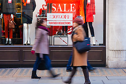 "London, December 20th 2014. Tens of thousands of shoppers descend on central London to scoop up pre-Christmas bargains as retailers offer discount incentives on ""Panic Saturday"". PICTURED: Shoppers are attracted by strong discounts as high street retailers compete for their pounds."