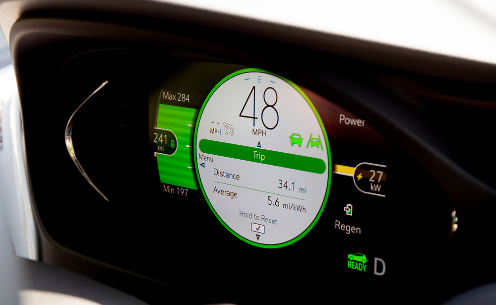 The instrument panel in Kevin Jones' Chevy Bolt gives him an idea of the remaining range on a charge during his morning commute into Royalton, Vt., on July 12, 2017. Jones, who commutes about 320 miles each week, said he has not had any fear of running out of battery power. (Photo by Geoff Hansen)