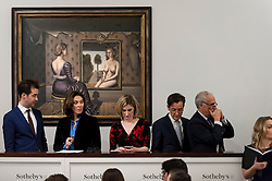 "© Licensed to London News Pictures. 03/03/2016. London, UK.  Paul Delvaux's ""Le Miroir"" (sold for a hammer price of £6.7m) hangs behind Sotheby's staff on the telephone to clients at Sotheby's Impressionist, Modern & Surrealist art evening sales in New Bond Street.  The combined total of the sale was forecast to realise between £97-138m. Photo credit : Stephen Chung/LNP"