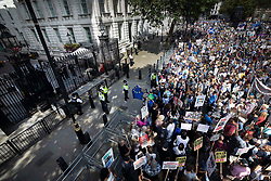 © Licensed to London News Pictures. 31/08/2019. London, UK. Demonstrators on the Stop The Coup march surround the entrance to Downing Street as they gather in Whitehall to protest against the government's plans to close Parliament early ahead of the party conference season. Photo credit: Peter Macdiarmid/LNP