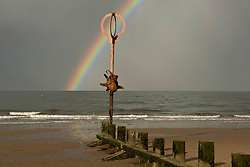 Portobello's beach octopus sculpture - Cressida - restored after the winter storms and a Spring showers rainbow.  © Jon Davey/ EEm