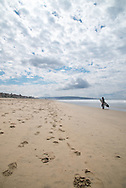 Photo surfer ocean wall art. Manhattan Beach landscape print. Surfer walking on the beach with perfect white clouds. El Porto, Southbay, CA. Matted print, limited edition. Fine art photography print.