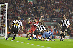 LIVERPOOL, ENGLAND - WEDNESDAY, SEPTEMBER 20th, 2006: Liverpool's Dirk Kuyt appeals for a penalty after Newcastle United's Celestine Babayaro handled the ball in the penalty area during the Premiership match at Anfield. (Pic by David Rawcliffe/Propaganda)