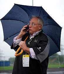 ALTACH, AUSTRIA - Saturday, July 17, 2010: Liverpool's co-owner George N. Gillett Jr. talks on his mobile phone after a lucrative televised match against Al-Hilal Al Saudi FC, the Reds' first preseason match of the 2010/2011 season, had to be called off due to torrential rain and a waterlogged pitch at the Cashpoint Arena. (Pic by David Rawcliffe/Propaganda)