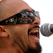 Musician Raul Pacheco, of the band Ozomatli, performs with guest musicians at an event in honor of Cesar Chavez,  held at Olvera Street,  in Los Angeles, Calif., on April 4, 2009. Photo by Jen Klewitz