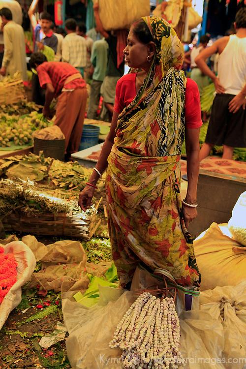 Asia, India, Calcutta. Woman in the flower market in Calcutta.