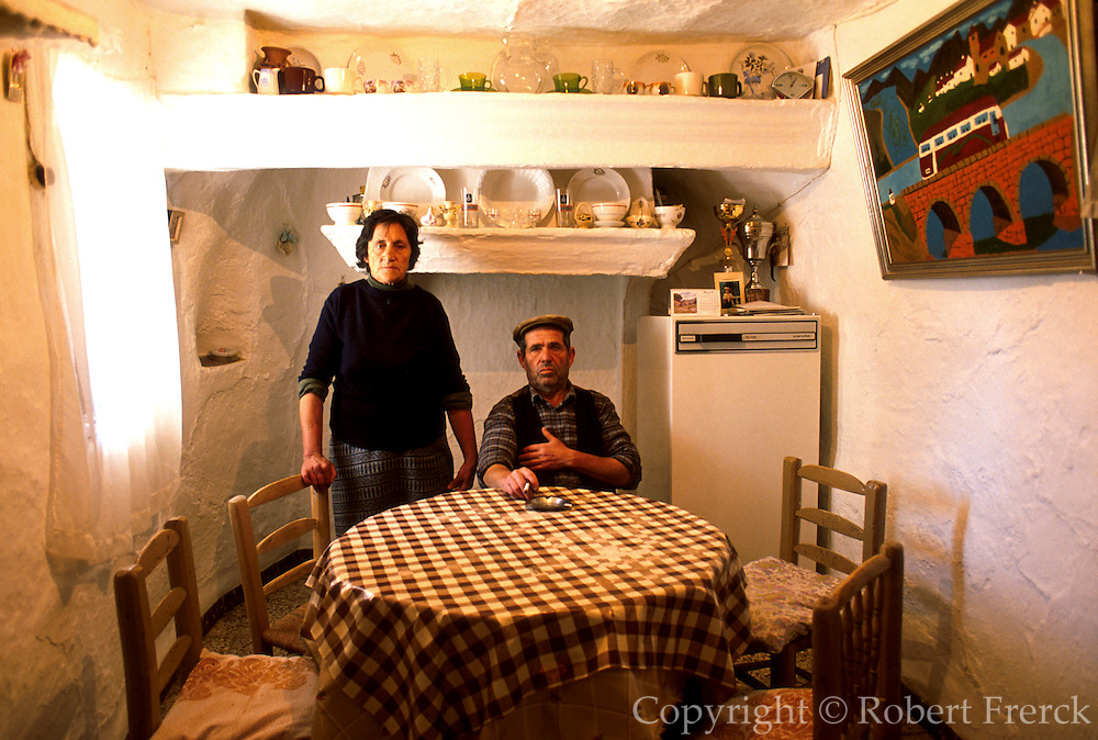 SPAIN, ANDALUSIA GUADIX; very ancient cave dwellings, 6000 inhabitants, interior of kitchen with owners, near Granada
